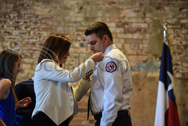 Assistant Fire Chief Paul Crayton is pinned by his wife during the Athens Fire and Rescue Swearing in Ceremony on Saturday, January 26. The special event took place at the Texan on Palestine. (Jessica T. Payne/Tyler Morning Telegraph)