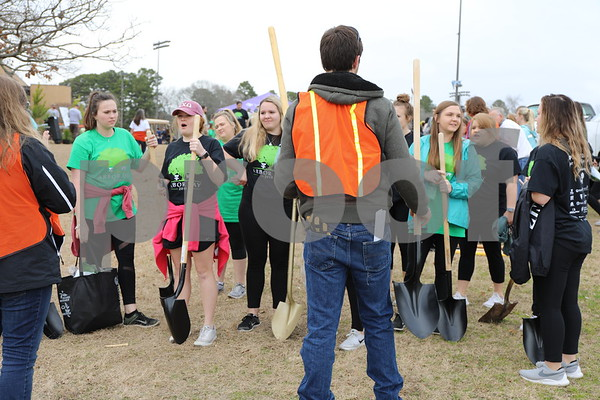 UT Tyler students with shovels to plant trees during the Tyler Arbor Day Event