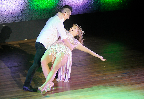 Don Knight | The Herald Bulletin<br /> Marly Hardy smiles as she is dipped by her partner Xavier Medina as they compete in Dancing Like the Stars at the Paramount on Saturday.