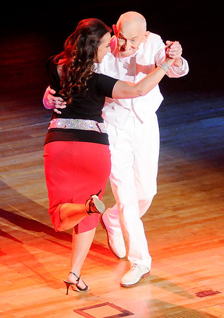 Don Knight | The Herald Bulletin<br /> Bob Arbuckle and Marie Roach perform an Argentine Tango during Dancing Like the Stars at the Paramount on Saturday.