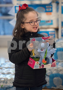Audrey Kirby shops at Big Lots in the French Quarter Shopping Center in Tyler on Friday Dec. 8, 2017. Over 50 East Texas students with visually impairments were given money to purchase a gift to donate to Toys for Tots during their Annual Christmas Outing and Shopping Event.  (Sarah A. Miller/Tyler Morning Telegraph)