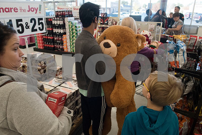 Students with visual impairments from across East Texas shop at Big Lots in the French Quarter Shopping Center in Tyler on Friday Dec. 8, 2017 for gifts to donate to Toys for Tots.  (Sarah A. Miller/Tyler Morning Telegraph)