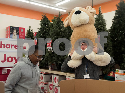 Marquel Braden, 15, and Austin Tant, 17, look through a box filled with large stuffed animals as they shop at Big Lots in the French Quarter Shopping Center in Tyler on Friday Dec. 8, 2017. Over 50 East Texas students with visually impairments were given money to purchase a gift to donate to Toys for Tots during their Annual Christmas Outing and Shopping Event.  (Sarah A. Miller/Tyler Morning Telegraph)
