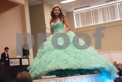 Mairely Camargo of Sulphur Springs models a dress from Tyler store Xpressions By Nico during the fashion show at the Bridal, Prom and Party Expo held Saturday Jan. 30, 2016 at Harvey Convention Center in Tyler. The 2nd annual event was sponsored by East Texas Wedding Extravaganza. The event included 100 vendors ranging from event photographers to bridal venues and catering services. The event concluded with a bridal, prom and Quinceanera fashion show.  (Sarah A. Miller/Tyler Morning Telegraph)