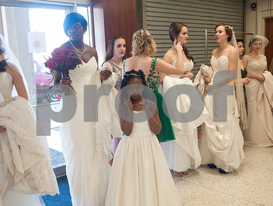 Shirrayna Turner of Tyler and her daughter Imani Russeau, 7, wait backstage in their dresses from Weddings A to Z during the Bridal, Prom and Party Expo held Saturday Jan. 30, 2016 at Harvey Convention Center in Tyler. The 2nd annual event was sponsored by East Texas Wedding Extravaganza. The event included 100 vendors ranging from event photographers to bridal venues and catering services. The event concluded with a bridal, prom and Quinceanera fashion show.  (Sarah A. Miller/Tyler Morning Telegraph)