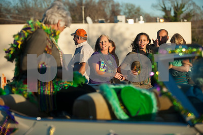 People follow the floats on Avenue A to catch beads and other treats during the annual Mardi Gras parade through the Main Street District in Palestine, Texas Saturday Jan. 30, 2016. The parade was presented by a Palestine based society group called The Mystics of Time. The parade followed the annual food focused Taste of New Orleans event also downtown.   (Sarah A. Miller/Tyler Morning Telegraph)