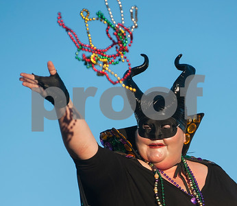 A reveler throws beads from the Mystics of Time float during the annual Mardi Gras parade through the Main Street District in Palestine, Texas Saturday Jan. 30, 2016. The parade was presented by a Palestine based society group called The Mystics of Time. The parade followed the annual food focused Taste of New Orleans event also downtown.   (Sarah A. Miller/Tyler Morning Telegraph)