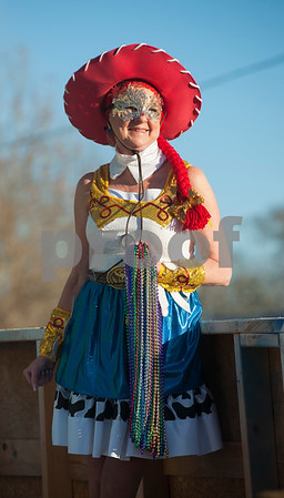 A reveler rides on a float during the annual Mardi Gras parade through the Main Street District in Palestine, Texas Saturday Jan. 30, 2016. The parade was presented by a Palestine based society group called The Mystics of Time. The parade followed the annual food focused Taste of New Orleans event also downtown.   (Sarah A. Miller/Tyler Morning Telegraph)