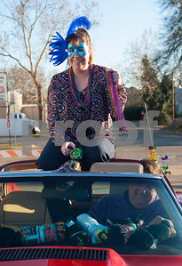 Jaclyn Capt of Palestine and Emery Capt ride in their 1976 Stingray in the annual Mardi Gras parade through the Main Street District in Palestine, Texas Saturday Jan. 30, 2016. The Capts are members of the car club Cars of Palestine. The parade was presented by a Palestine based society group called The Mystics of Time. The parade followed the annual food focused Taste of New Orleans event also downtown.   (Sarah A. Miller/Tyler Morning Telegraph)