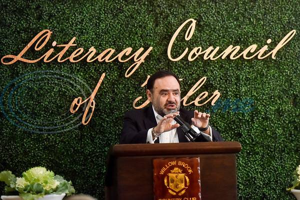 """Dr. Juan Mejia, president for branch locations and district provost for TJC, speaks during the Literacy Council of Tyler donor luncheon at Willow Brook Country Club in Tyler, Texas, on Wednesday Jan. 29, 2019. This year's theme, """"Garden Party,"""" is designed to reflect the critical role donors play in the life of LCOT and its students. (Chelsea Purgahn/Tyler Morning Telegraph)"""
