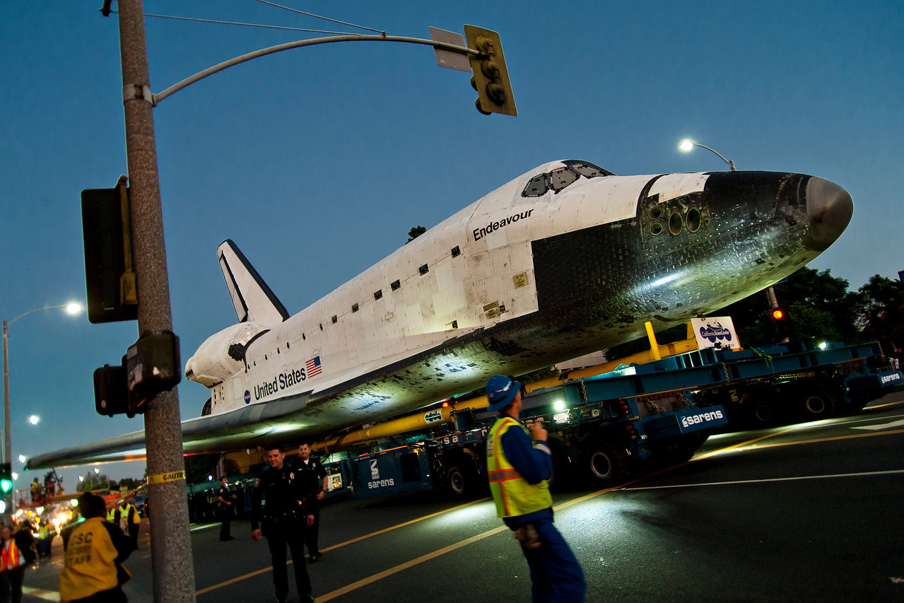 The Space Shuttle Endeavour travels along Manchester Blvd. before Inglewood City Hall, making its final journey to The Discovery Science Center, Saturday, October 13, 2012 (Photo by Tom Sorensen/Moovieboy Pictures)