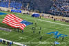 A parachutist who is a double amputee has nearly reached the ground in the stadium at the U.S. Air Force Academy during the pre-game demonstration at the Air Force/Army football game on November 7, 2009.  If you view the image in the largest sizes, you can see his prothetics.
