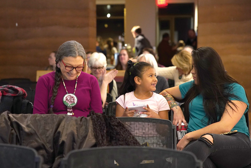 Matthew Gaston | The Sheridan Press<br>Dr. Janine Pease, left, smiles and laughs with her granddaughters at The Brinton Museum during the 150th anniversary of Wyoming women's suffrage Tuesday, Dec. 10, 2019. Pease provided her perspective on the panel following the documentary screening.