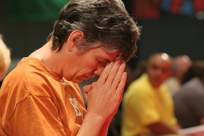 Debbie Louden of Corpus Christi Church, Lexington, S.C., prays after receiving holy Communion. This was Louden's first time at the Eucharistic Congress.