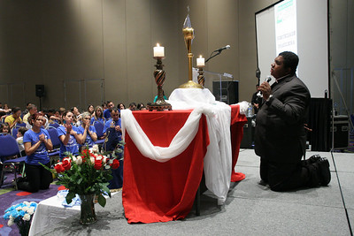 Father Roger Araujo, parochial vicar for the Brazilian community at Holy Family Church, Marietta, leads the congregation in prayer during the Brazilian Track, June 4.