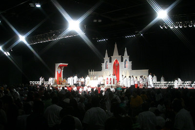 Clergy distribute holy Communion to the massive crowd of congress-goers attending the closing Mass.