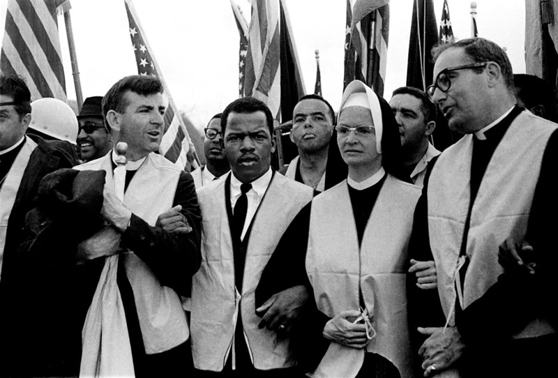 Head of march. Nuns, priests, civil rights leaders: <br /> •left front folded arms: Rev. Arthur Matott  Presbyterian Minister, Perth Amboy, NJ<br /> •2nd left: John Lewis, Head of SNCC<br /> •3rd left, 2nd row: Andrew Young<br /> •4th left, front: Sister Mary Leoline<br /> Selma to Montgomery, Alabama Civil Rights March; March 25, 1965<br />     - Photo by Stephen Somerstein©