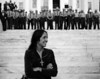 Joan Baez, folk singer, in front of State Troopers, Montgomery Alabama State House. Conclusion of Selma To Montgomery Alabama Civil Rights March - March 25, 1965<br /> Selma to Montgomery, Alabama Civil Rights March; March 25, 1965<br />     - Photo by Stephen Somerstein©