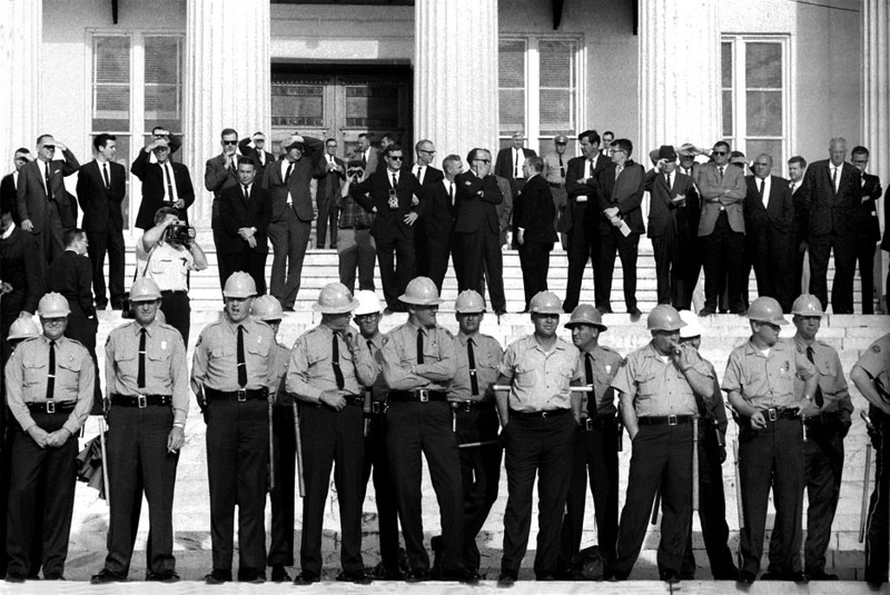 State troopers arrayed on steps of Montgomery, Alabama State House. Officials on top steps - March 25, 1965<br /> Selma to Montgomery, Alabama Civil Rights March; March 25, 1965<br />     - Photo by Stephen Somerstein©