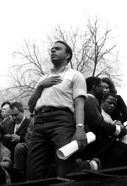 Andrew Young with hand over heart, after singing the National Anthem; Bernard King, and on right John Lewis<br /> Selma to Montgomery, Alabama Civil Rights March; March 25, 1965<br />     - Photo by Stephen Somerstein©