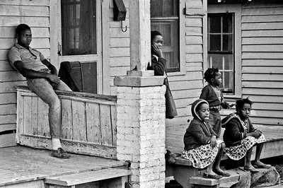 Selma to Montgomery, Alabama civil Rights March, March 25, 1965: Black children & teenager watching marchers from their porch.