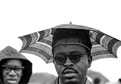 Umbrella-hatted black marcher - Selma to Montgomery, Alabama civil rights march. March 25, 1965. Photo taken along road on Selma to Montgomery, Alabama civil rights march.