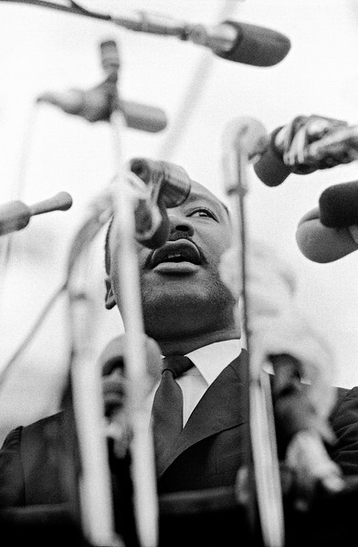Dr. Martin Luther King, Jr. speaking before crowd of civil rights marchers, in front of Montgomery, Alabama state capital building. March 25, 1965<br />  - Photo by Stephen Somerstein©