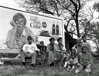 """Things Go Better With Coke"" sign with multi-generational family watching Selma marchers.  Selma To Montgomery, Alabama Civil Rights March, March 25, 1965"