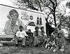 """""""Things Go Better With Coke"""" sign and multi-generational family watching marchers.<br /> <br /> Selma To Montgomery Civil Rights March, March 25, 1965, Coca Cola sign"""