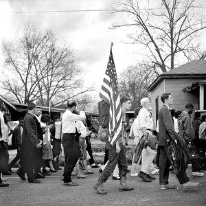 Selma To Montgomery, Alabama Civil Rights March, March 25, 1965:  White and Negro marchers traveling along route 80, Jefferson Davis Highway. American flag carried in center of image.