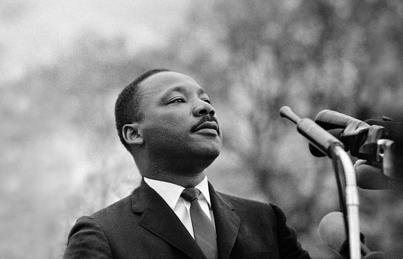 Dr. Martin Luther King, Jr. speaking before crowd of 25,000 civil rights marchers, in front of Montgomery, Alabama state capital building. Selma To Montgomery Alabama Civil Rights March,  March 25, 1965<br />  - Photo by Stephen Somerstein©