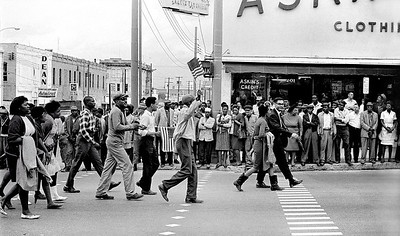 Civil Rights Marchers, with watching crowd on curb.  Selma to Montgomery, Alabama civil Rights March, March 25, 1965