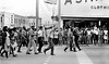 Marchers, with watching crowd on curb.<br /> <br /> Selma to Montgomery, Alabama civil Rights March, March 24-26, 1965
