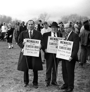Three Teamster Union members, Local 239, with signs supporting Civil Rights Selma to Montgomery, Alabama Civil Rights March; March 25, 1965 - Photo by Stephen Somerstein©