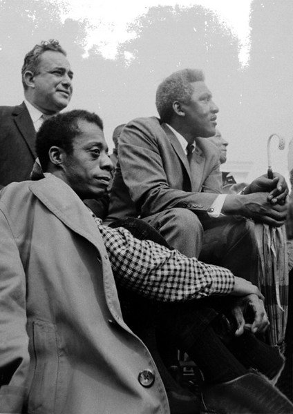 Left front: James Baldwin, author,  overcoat over shoulders<br /> Right front: Bayard Rustin, march coordinator<br /> Left rear: Union leader<br /> Right rear: A. Philip Randolph, President of the Brotherhood of Sleeping Car Porters<br /> Selma to Montgomery, Alabama Civil Rights March; March 25, 1965<br />     - Photo by Stephen Somerstein©