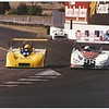 Dave Arken in the #31 yellow A-Mac on the left, and John Bosso in the #95 white Fox on the right.