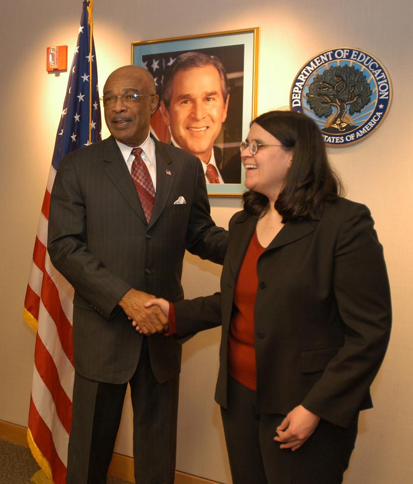 US Secretary of Education, Rod Paige, congratulates Helaine Blumenthal.
