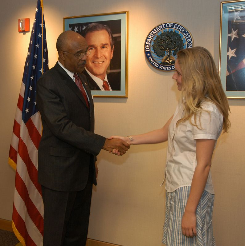 US Secretary of Education, Rod Paige, congratulates Emily Kalah Gade.