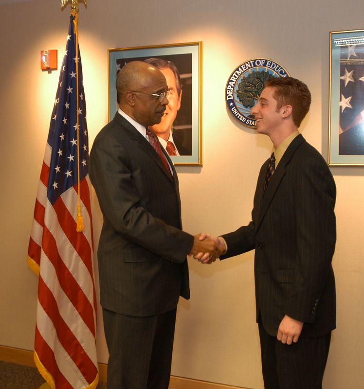 US Secretary of Education, Rod Paige, congratulates Justin Sirico Stroup.