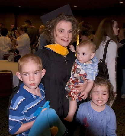 """<br><br><font size=""""3"""">Graduate Mom and her kids.</font>"""
