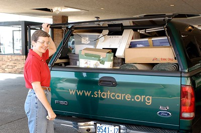 STATCARE's Beverly Ford arrives at the conference with the material for their Expo booth at the Kentucky EMS Conference and Expo.