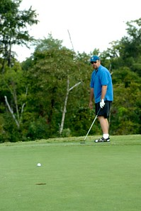 David Webb tries to sink a put at the Kentucky EMS Conference and Expo Golf Scramble. The Summit Golf Course.