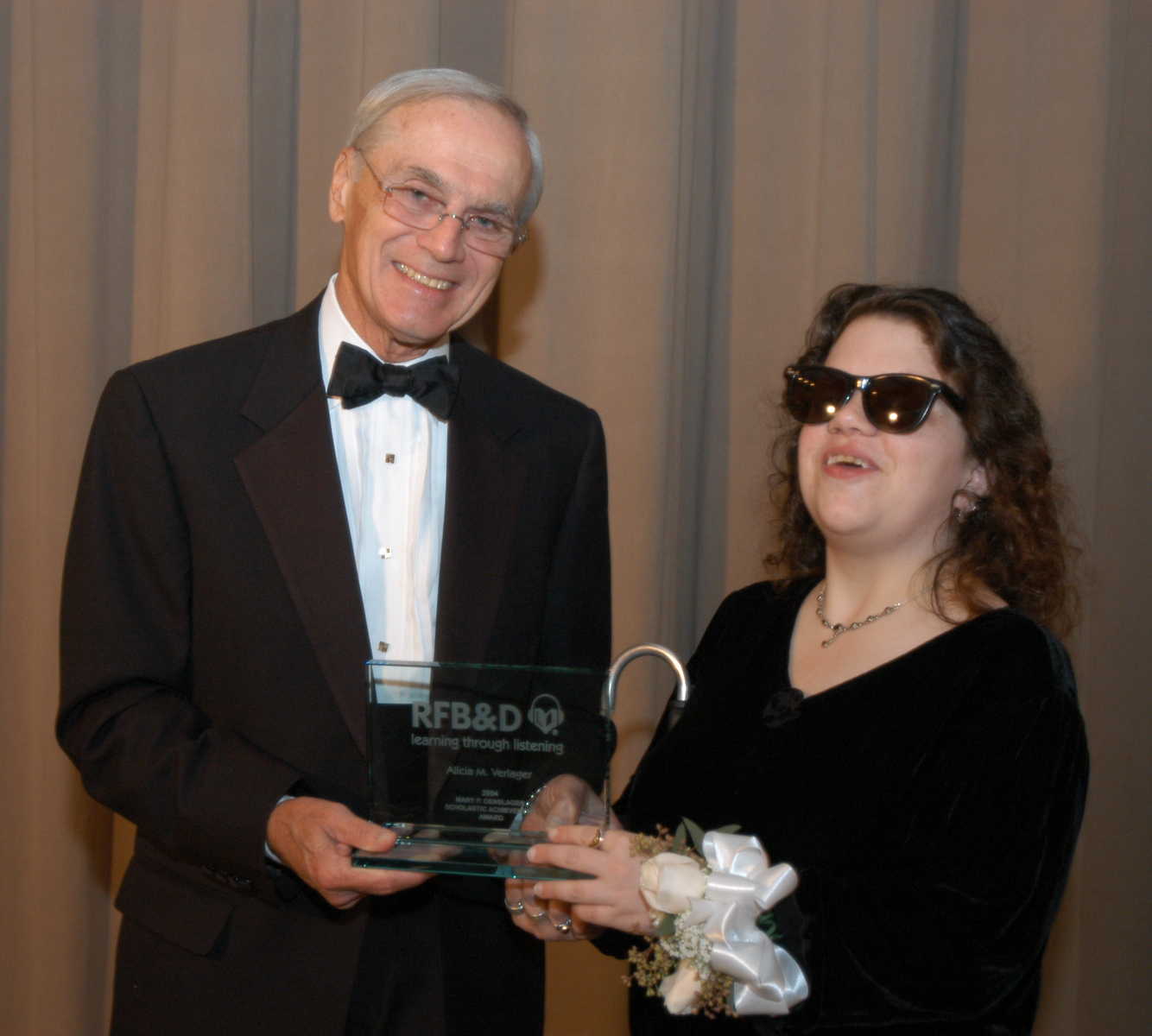 RFB&D President & CEO Richard O. Scribner presents a National Achievement Award to Alicia Verlager.