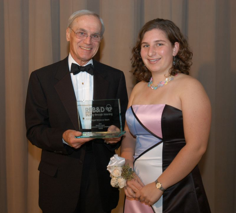 RFB&D President & CEO Richard O. Scribner presents a National Achievement Award to Abigail Baum.