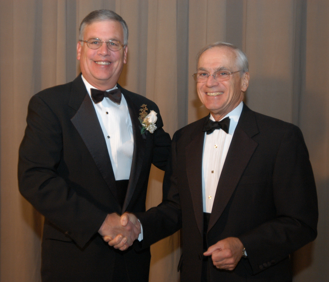 Richard O. Scribner, RFB&D president & CEO, congratulates Peter K. Classen, CEO, Corporate Banking, PNC Bank. PNC Bank was the recipient of RFB&D's 2004 Enabling America Award.