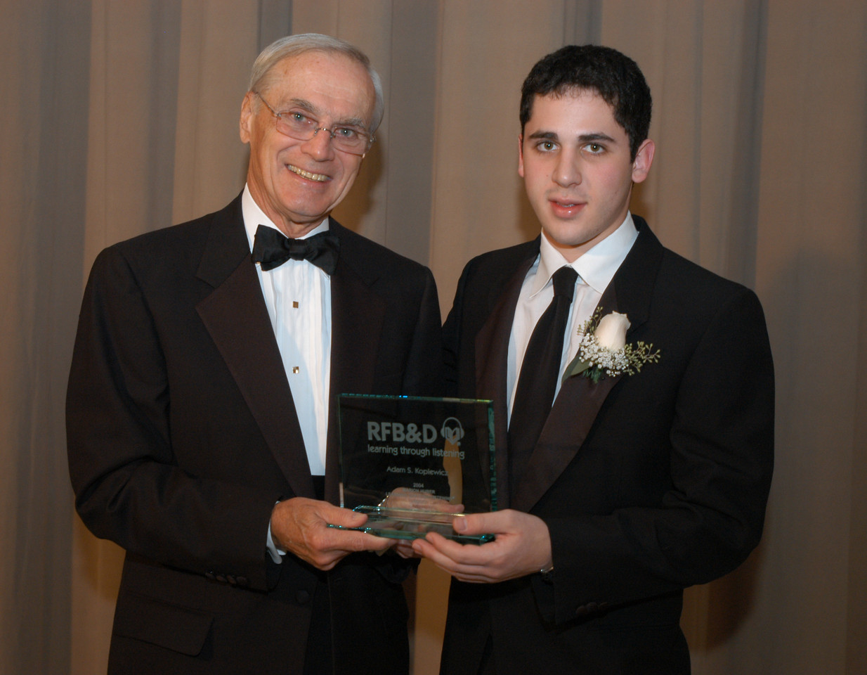 RFB&D President & CEO Richard O. Scribner presents a National Achievement Award to Adam Koplewicz.