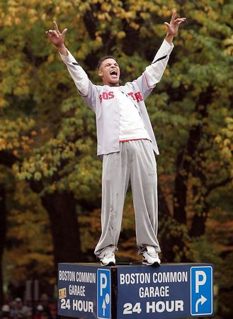 An unidentified Red Sox fan lets out a scream while standing atop a Boston Common parking sign