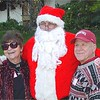 Mary Jo and Ron Harris take a picture with Santa.