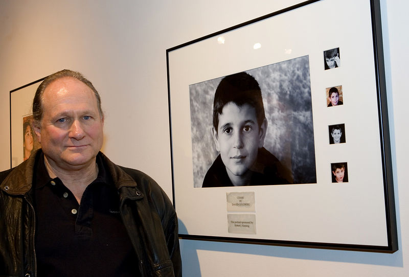 Photographer David Goldberg with his portrait of Chase