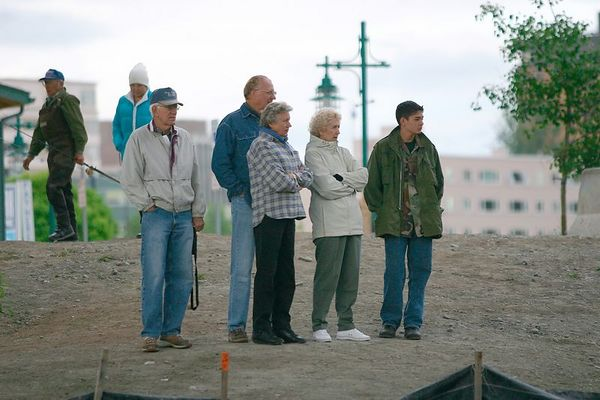 A group of tourists watch the action a Ship Creek.  Believe me, the Ship Creek fishery can be very entertaining.
